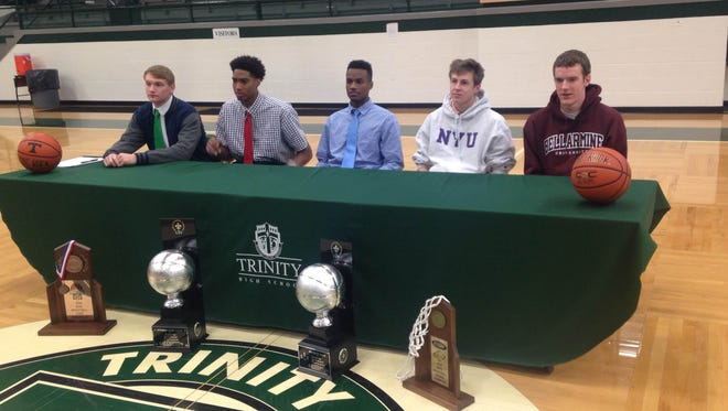 From left, Trinity's Christian Thieneman (Marshall), Raymond Spalding (Louisville), D'Angelo West (Texas State), Jay Murphy (NYU) and Daniel Ramser (Bellarmine) sign with their colleges