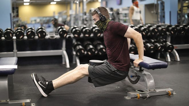 """Steve Kay of Weymouth was using the gym 5 days a week until it closed in March.   As """"phase 3Ó of the state Covid 19 reopening members of Northeast Health and Fitness get back into the Weymouth gym on Washington Street on Monday July 6, 2020 Greg Derr/The Patriot Ledger"""