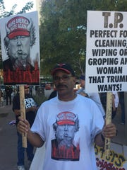 John Chambers, 68, of south Phoenix carried signs characterizing