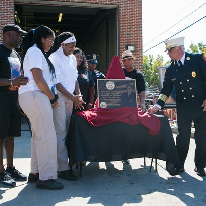 Family members of Lt. Ardythe Hope attend the dedication