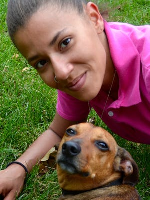 Julie Ritchie says she is overwhelmed with happiness to be reunited with her medical companion dog named Koko.
