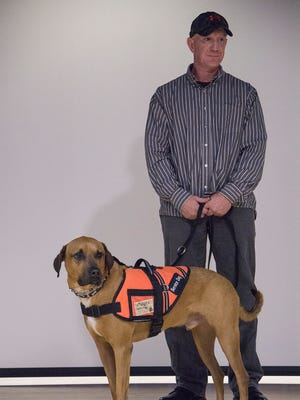 """This dog gave me my life back."" says veteran GL Mason, of Ammo, his service dog provided by Stiggy's Dogs,"