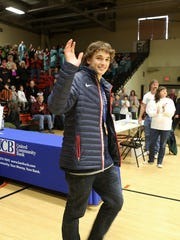 Olympian Nick Goepper arrives at a reception on his