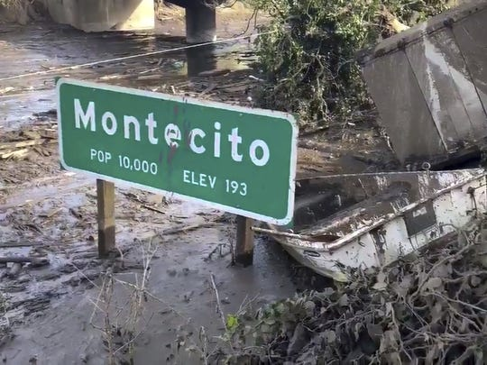 In this image provided by the Santa Barbara County Fire Department, Highway 101 remains underwater as cleanup crews work to clear mud and debris throughout Montecito in January 2018.