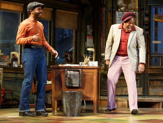 "Andre Holland (left) with Ray Anthony Thomas in ""Jitney."""
