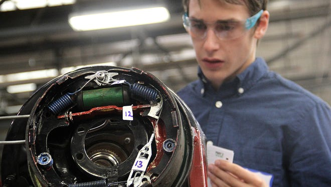 Beau Claridge, a senior at Brighton High School in Brighton, Colo., competes in San Juan College's annual SkillsUSA invitational on Friday at the school's auto technician shop in Farmington.