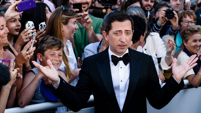 "Gad Elmaleh arrives at the ""Elle"" premiere during the 69th annual Cannes Film Festival in May."