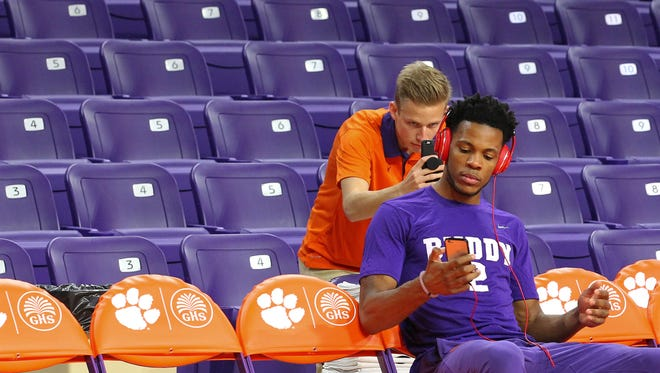 Clemson forward Jaron Blossomgame (5) looks at his phone with headphones on before tipoff with N.C. State on Wednesday in Littlejohn Coliseum in Clemson.