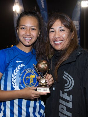 Guam Shipyard's Brianne Leon Guerrero receives the 2018 Bud Light Women's Soccer League Premier Division spring season Golden Boot Award from Rhoda Bamba, Guam Football Association executive committee member and Women's Committee chairperson.
