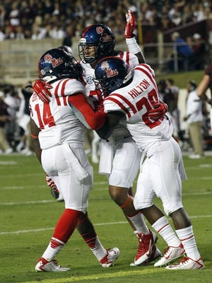 Ole Miss safety Cody Prewitt is congratulated by teammates after returning an interception 75 yards for a touchdown against Texas A&M.