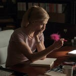 "Rosamund Pike appears in a scene from ""Gone Girl,"" the film based on the best-selling novel."