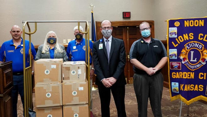 The Garden City Noon Lions Club has donated 12,000 medium and small rubber gloves to St. Catherine Hospital. From left are: Tom Baumann, Diana Baumann, Randy St. Auburn, all officials of the District 17-K Lions Club, Andy Flemer, St Catherine Hospital interim CEO, and Sean Collins, Garden City Noon Lions Club president.