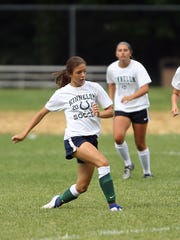 Kinnelon freshman Rebecca Racine, l,  passes the ball during practice. September 1, 2016, Kinnelon, NJ