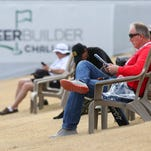 Spectators watch the pros on the range before the start of  CareerBuilder Challenge, January 23, 2016.