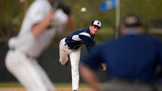 Bay Port pitcher Connor Hock (3) fires a pitch against Green Bay Preble during Thursday's baseball game at Joannes Stadium in Green Bay. Hock allowed just one hit for the Pirates. Bay Port defeated Preble 11-0.