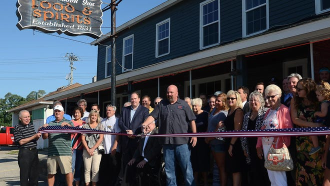 The New Hudson Inn in celebrated its grand re-opening ribbon cutting ceremony on Aug. 1 with a large crowd. The Inn, built in 1885, was refurbished on its interior and was closed for three months.
