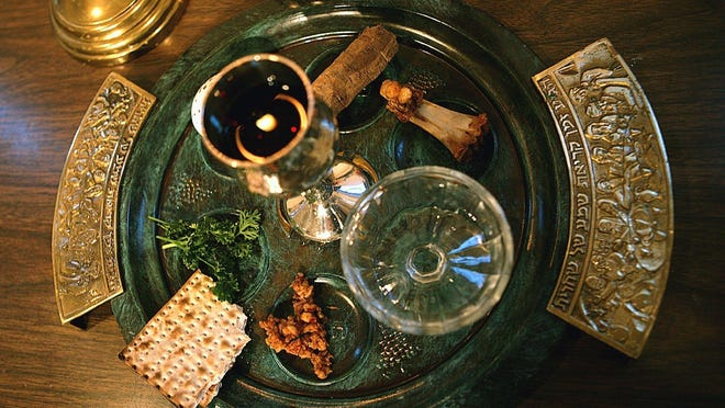 A traditional Passover seder plate is seen at Congregation Beth El in Tyler, Texas, on the first night of Passover in 2006. For some Jews this year, Passover Seder will connect the exodus story with today's global refugee crisis through special recitations and rituals.