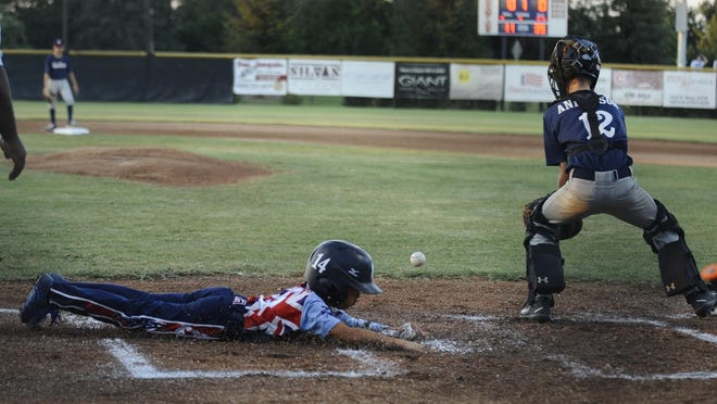 Hawaii's Shareh Sarono slides into home plate against Los Altos from Long Beach during the Pacific Southwest Regional Tournament at Riverway Sports Park in Visalia on July 22, 2017. Hawaii ended up winning 10-0 in the championship game.