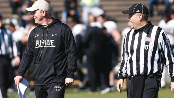 John Terhune/Journal & Courier Head coach Jeff Brohm has a laugh during Purdue?s scrimmage on April 1. Brohm says his primary recruiting focus will be on areas within three or four hours of campus. Head coach Jeff Brohm has a laugh during Purdue's scrimmage Saturday, April 1, 2017, at Ross-Ade Stadium.