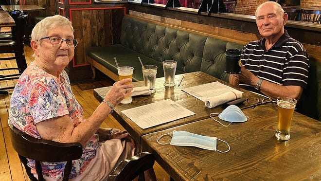 """Restaurant lovers Bob Muchoney, 89, and his wife, Cis Muchoney, 90, have been taking advantage of Skunk & Goat Tavern's """"high-risk"""" dining hour for guests with special concerns about COVID-19."""