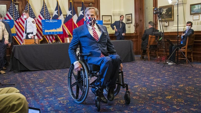 Gov. Greg Abbott exits the room after a press conference on Monday where he said he has no plans to shut down the state again. Austin-Travis County health officials on Sunday reported another record number of newly confirmed cases of COVID-19.