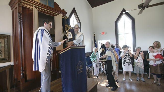 Rabbi Daniel Millner of the Congregation Tiferet Israel leads the dedication of the B'Nai Abraham Brenham Historic Synagogue on the Dell Jewish Community Center campus in 2015.