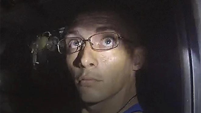 In this image, released by the Georgia Bureau of Investigation, taken from a deputy's body camera, Texas fugitive Dalton Potter is questioned during a traffic stop on Monday, Sept. 7, 2020, in Dalton, Ga. A GBI statement released Tuesday, Sept. 8, said one of two Texas fugitives wanted after a Georgia deputy was shot during the traffic stop, Jonathan Hosmer, has been apprehended, while Potter remains at large.