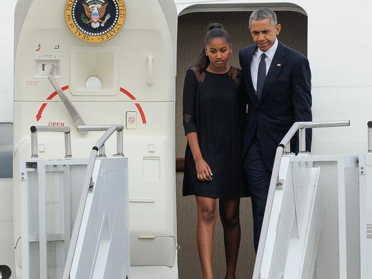 President Barack Obama and daughter Sasha exit Air