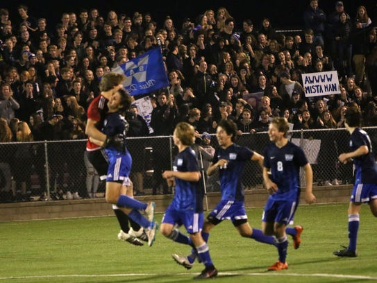 Whitefish Bay players react in front of thier fans