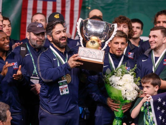 Members of Team USA celebrate after winning the 2018 freestyle wrestling World Cup, 6-4, over Azerbaijan in Iowa City on Sunday, April 8, 2018.