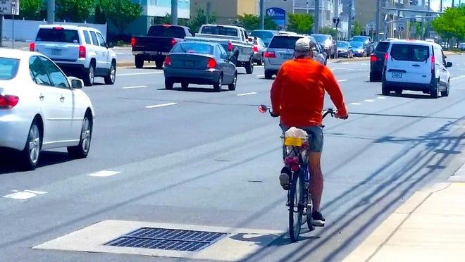A cyclist makes his way down Coastal Highway in Ocean City.