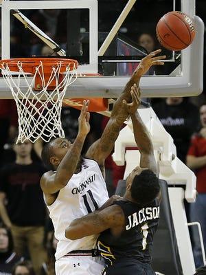 Cincinnati Bearcats forward Gary Clark swats away a shot by Arkansas-Pine Bluff guard Charles Jackson during Tuesday's 77-49 UC win. Clark ranks No. 5 on the UC career blocks list with 154.