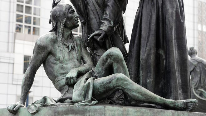 This Friday, March 2, 2018 photo shows a statue of a Native American below Sir Francis Drake and Father Junipero Serra in San Francisco. San Francisco's arts commission is considering removing a statue that some say is degrading to Native Americans.