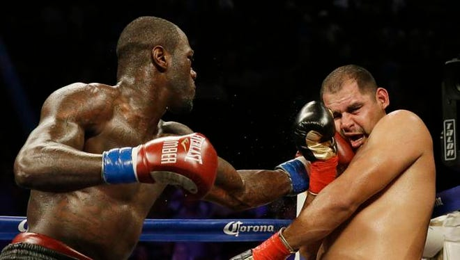 Deontay Wilder punches Eric Molina during the WBC heavyweight boxing match, Saturday, June 13, 2015, in Birmingham, Ala. (AP Photo/Brynn Anderson)