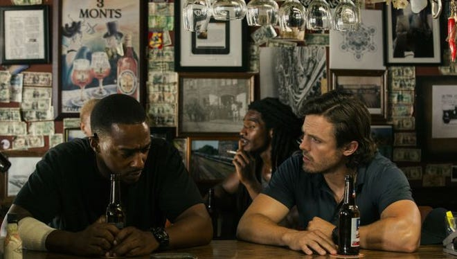 """Anthony Mackie, left, and Casy Affleck star in """"Triple 9."""""""