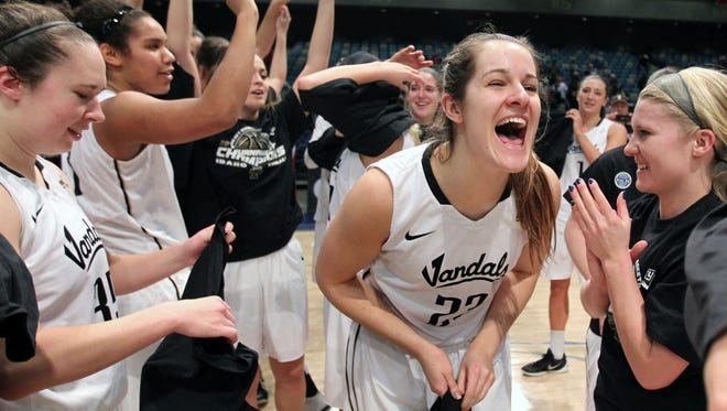 Idaho forward Renae Mokrzycki (23) celebrates with her team after Idaho defeated Idaho State 67-55 for the Big Sky Conference women's tournament title Saturday.