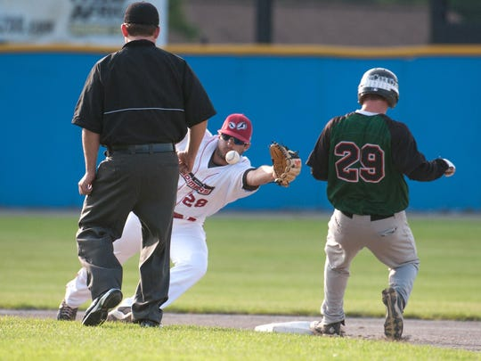 Bombers second baseman Christian Helsel dives for the