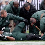 MSU lineman Dennis Finley is injured with a broken leg against Purdue at Spartan Stadium Saturday 10/3/2015.