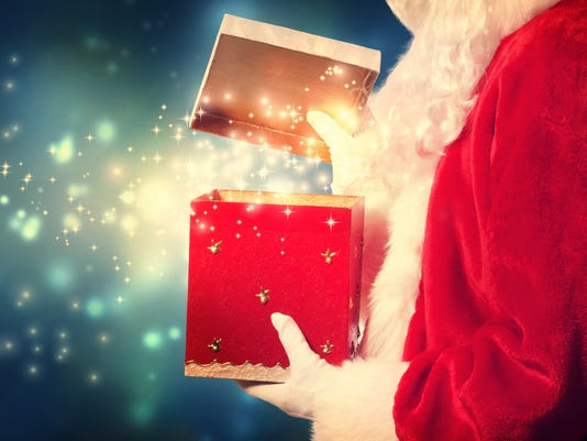 Santa Claus opening a red Christmas present