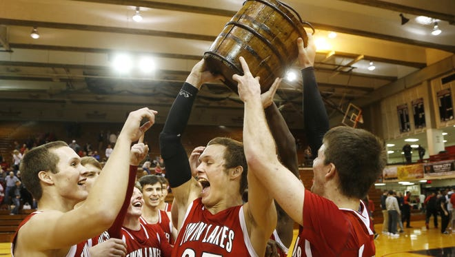 Twin Lakes celebrates last year's boys J&C Hoops Classic championship. The Indians were the third different team in three years to win the title.