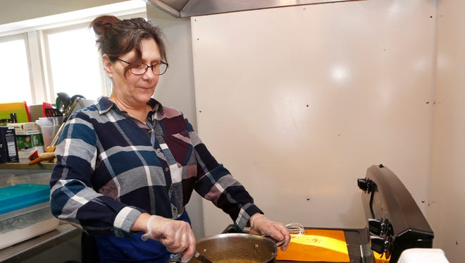 Teresa Warner prepares rosemary gravy for sirloin tip pot pies Wednesday, January 17, 2018, at Local Motive Meals, a dinner delivery service, at 294 Market Street in Dayton.