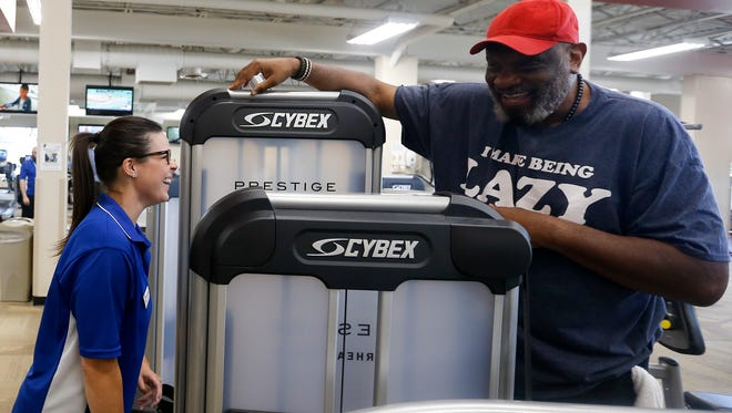 """Samantha Schultz talks to George Crowe, a regular gym goer, in the middle of his workout at Benjamin Harrison YMCA on Monday, June 4, 2018. """"The Y benefits from having her here. She goes above and beyond the call of duty,"""" Crowe said."""