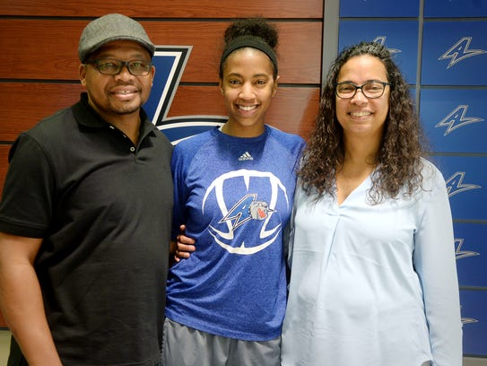 UNCA basketball player KJ Weaver with her parents,