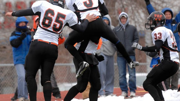 Washington players celebrate a touchdown against O'Gorman during the 2008 state semifinals at McEneaney Field.