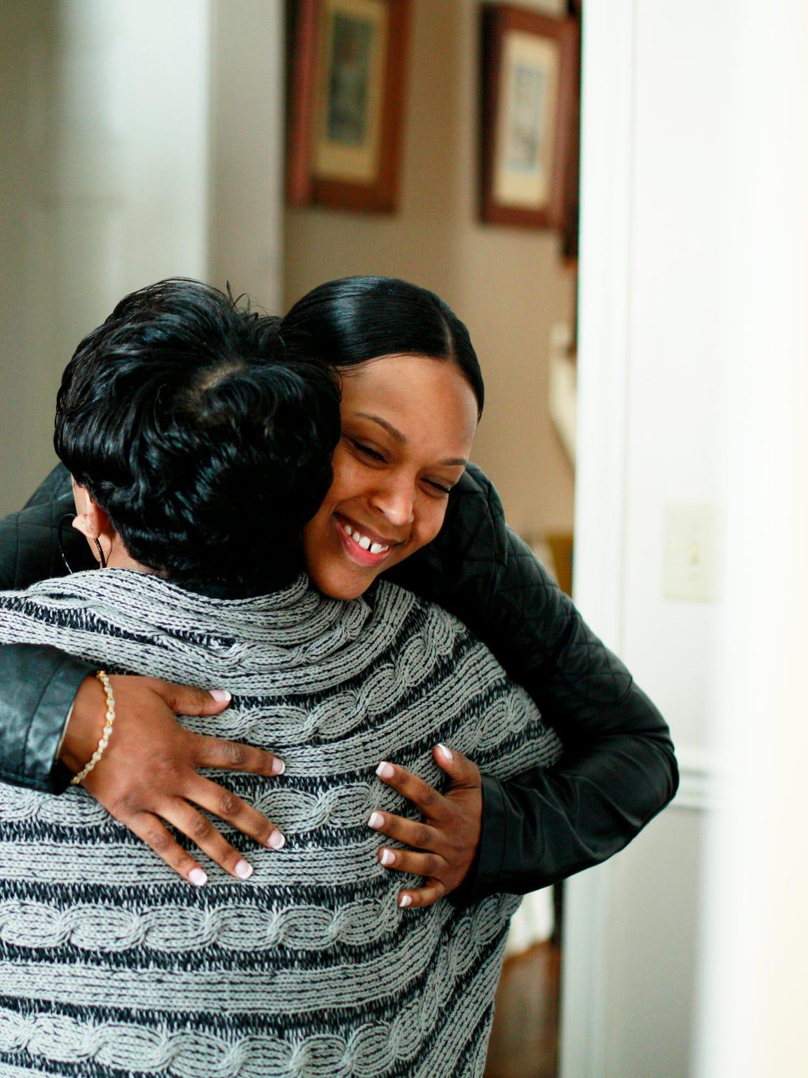 Sudana Wilmott hugs T-Ann Johnson who is helping her