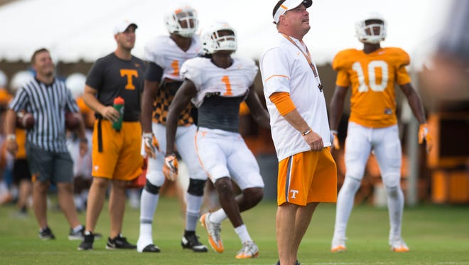 Tennessee Head Coach Butch Jones looks up at a throw with players during a University of Tennessee fall football practice at Anderson Training Facility in Knoxville, Tenn. on Tuesday, Aug. 15, 2017.
