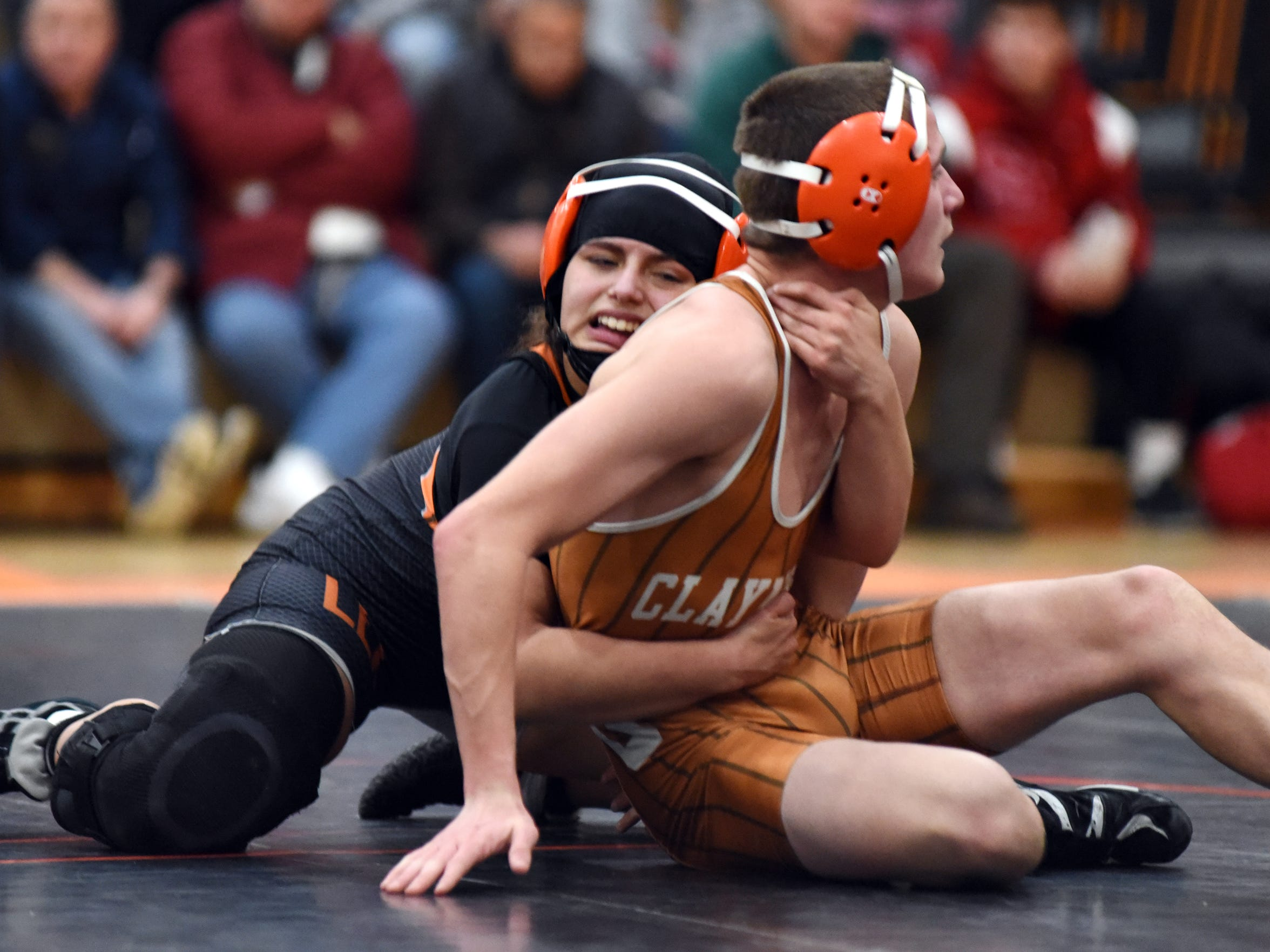 New Lexington's Leilah Castro wrestles Claymont's Grant
