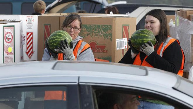 Volunteers with Second Harvest Food Bank participate in a Tailgate event.