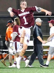 Dan Diederich jumps for joy after Aquinas upset top seed Indiana Tech.