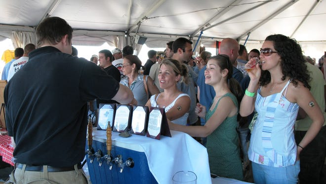 Visitors attend a past Garden State Craft Brewers Guild Beer Festival aboard the Battleship New Jersey.